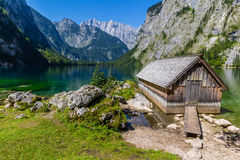 Beautiful landscape of alpine lake with crystal clear green water and mountains in background, Obersee, Germany.  Royalty Free Stock Photography