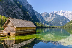 Beautiful landscape of alpine lake with crystal clear green water and mountains in background, Obersee, Germany Royalty Free Stock Images