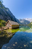 Beautiful landscape of alpine lake with crystal clear green water and mountains in background, Obersee, Germany Stock Image