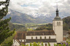 Beautiful landscape with Alps mountains and cementery, Gruyeres, Switzerland Stock Photos
