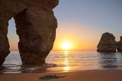 Beautiful landscape with amazing sunrise on the rocky atlantic ocean coast within the Lagos, Portugal. Royalty Free Stock Photography