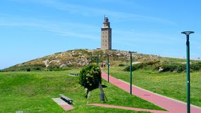 Beautiful landscape with ancient Tower Hercules. Beautiful summer landscape with ancient Roman Tower Hercules in Spain Stock Photos