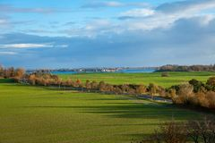 Beautiful landscape in autum baltic see green field blue sky Stock Image