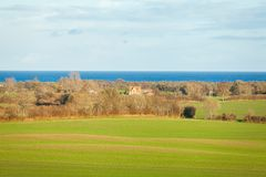 Beautiful landscape in autum baltic see green field blue sky Royalty Free Stock Images