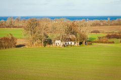 Beautiful landscape in autum baltic see green field blue sky Royalty Free Stock Photo