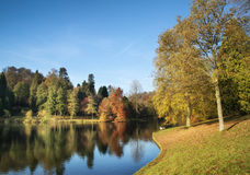 Beautiful landscape of Autumn trees and colors reflected in lake Stock Photo