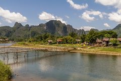 The beautiful landscape with bamboo bridge on the Nam Song river in Vang Vieng, Laos. Asia royalty free stock photos