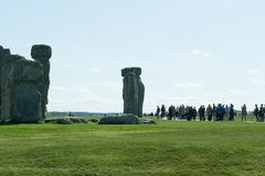 The path to Stonehenge - UNESCO World Heritage Site. A beautiful landscape with beautiful plantations of flowers and green grass. Prehistoric monument that royalty free stock photography