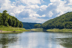 Beautiful landscape with blue water in a river and green trees i. N forest on mountain hills Royalty Free Stock Photos