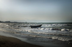 Beautiful landscape of Boat on the beach in cloudy weather. Vintage Boat in the seashore. Azerbaijan Stock Image