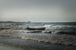 Beautiful landscape of Boat on the beach in cloudy weather. Vintage Boat in the seashore. Azerbaijan Stock Photography