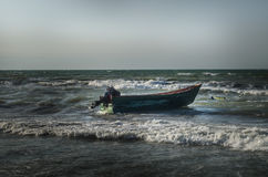 Beautiful landscape of Boat on the beach in cloudy weather. Vintage Boat in the seashore. Azerbaijan Stock Photo