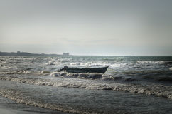 Beautiful landscape of Boat on the beach in cloudy weather. Vintage Boat in the seashore. Azerbaijan Stock Images