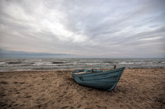 Beautiful landscape of Boat on the beach in cloudy weather. Vintage Boat in the seashore. Azerbaijan Caspian Sea Novkhani Stock Photo