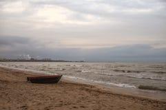 Beautiful landscape of Boat on the beach in cloudy weather. Vintage Boat in the seashore. Azerbaijan Caspian Sea Novkhani Stock Image
