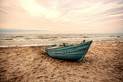 Beautiful landscape of Boat on the beach in cloudy weather. Vintage Boat in the seashore. Azerbaijan Caspian Sea Novkhani Royalty Free Stock Image