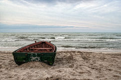 Beautiful landscape of Boat on the beach in cloudy weather. Vintage Boat in the seashore. Azerbaijan Caspian Sea Novkhani Stock Photography