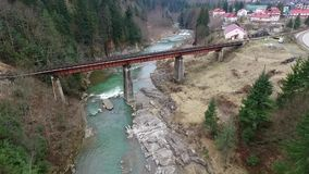 Beautiful landscape of bridge over mountain river. In Carpathians, aerial shoot stock video