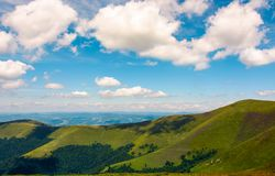 Beautiful landscape of Carpathian mountains. Grassy hills of Borzhava ridge under the blue sky with fluffy clouds Stock Images