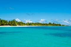 Beautiful landscape of clear turquoise Indian ocean. Water villas and a tropical island on the horizon, Maldives islands Stock Photography