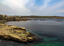 Beautiful landscape with clear turquoise water in Saint Pauls Bay, Bugibba, on Mediterranean island of Malta, Europe royalty free stock image
