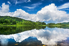 Beautiful landscape with cloudy blue sky reflected in the clear Royalty Free Stock Photography
