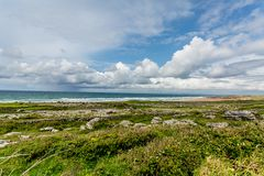 Beautiful landscape of the coast with limestone rocks with grass next to the Fanore beach. Geosite and geopark, Wild Atlantic Way, spring day in County Clare stock images