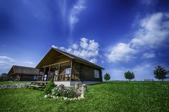 Confortable summer cottage, mortgage concept. Beautiful landscape of cottage in the green under blue sky Stock Photo