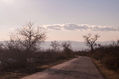 Beautiful landscape of country side road with trees in winter time at sunset. Azerbaijan, Caucasus, Sheki, Gakh, Zagatala Royalty Free Stock Photography