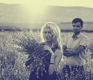 Beautiful landscape and couple in love with flowers on sunset. Black and white. Royalty Free Stock Photos