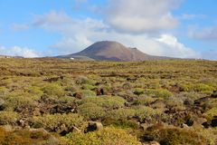 Beautiful landscape with crater volcano La Corona on the background, Lanzarote, Canary Islands royalty free stock images