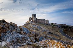 Beautiful landscape of Enisala old stronghold citadel with cloudy sky and rocks Royalty Free Stock Photo