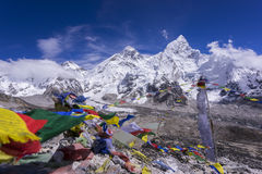 Beautiful Landscape of Everest and Lhotse peak with colorful Nepali flag as foreground from Kala Pattar view point. Gorak Shep. During the way to Everest base Stock Photos
