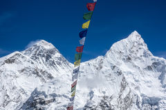 Beautiful Landscape of  Everest and Lhotse peak with colorful Nepali flag from Kala Pattar view point. Gorak Shep. During the way to Everest base camp Stock Image