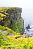 Cliffs of Moher and OBriens Tower Ireland. Beautiful landscape at the famous Cliffs of Moher and  O`Brien`s Tower in Co. Clare, Europe, ireland Royalty Free Stock Image
