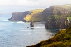 Cliffs of Moher and OBriens Tower Ireland. Beautiful landscape at the famous Cliffs of Moher and  O`Brien`s Tower in Co. Clare, Europe, ireland Stock Image