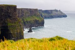 Cliffs of Moher and OBriens Tower Ireland. Beautiful landscape at the famous Cliffs of Moher and  O`Brien`s Tower in Co. Clare, Europe, ireland Stock Photography