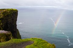 Rainbow at Cliffs of Moher. Beautiful landscape at the famous Cliffs of Moher and  O`Brien`s Tower in Co. Clare, Europe, ireland Royalty Free Stock Photography