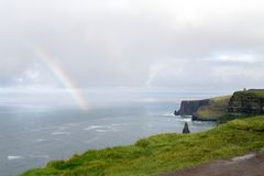 Rainbow at Cliffs of Moher. Beautiful landscape at the famous Cliffs of Moher and  O`Brien`s Tower in Co. Clare, Europe, ireland Royalty Free Stock Photos
