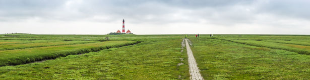 Beautiful landscape with famous Westerheversand lighthouse at North Sea in Nordfriesland, Schleswig-Holstein, Germany Stock Image