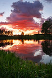 Beautiful landscape with fiery sunset over the lake Royalty Free Stock Photography