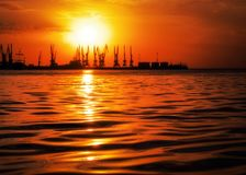 Beautiful landscape with fiery sunset sky and sea. Royalty Free Stock Photography