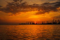 Beautiful landscape with fiery sunset sky and sea. Royalty Free Stock Images