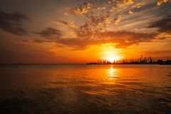Beautiful landscape with fiery sunset sky and sea. Stock Images