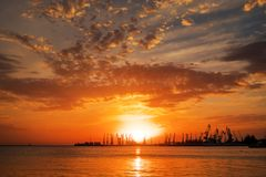 Beautiful landscape with fiery sunset sky and sea. Royalty Free Stock Photo