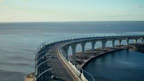 Beautiful landscape from flying drone car traffic on modern highway bridge. Beautiful landscape from flying drone car traffic on highway bridge over sea bay. Car stock footage