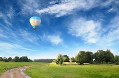 Beautiful Landscape with Flying Hot Air Ballon