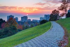 Arboretum and buildings on the background of sunset, Sochi, Russ. Beautiful landscape with footpath on the hill in Arboretum on the background of the apartment Stock Photography