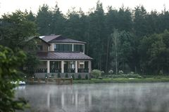 Beautiful landscape with forest and house. Near lake. Summer camp location stock photos