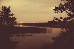 Beautiful landscape of forest and lake at sunset. Royalty Free Stock Images